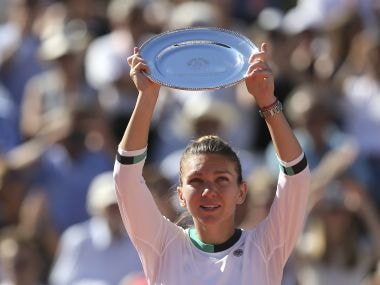 Romania's Simona Halep holds her plate after lossing to Latvia's Jelena Ostapenko in their final match of the French Open tennis tournament at the Roland Garros stadium, Saturday, June 10, 2017 in Paris. Ostapenko won 4-6, 6-4, 6-3. (AP Photo/David Vincent)