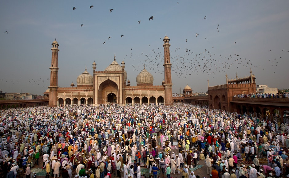 The festival marks the culmination of fasting. The holy month of Ramadan, the ninth month of the Islamic lunar calendar, is observed as a fasting period by Muslims who abstain from food and water from sunrise to sunset. In this photo, Muslims hug and greet each other after Eid-ul-Fitr prayers at the Jama Masjid Mosque in New Delhi, India on Monday. AP