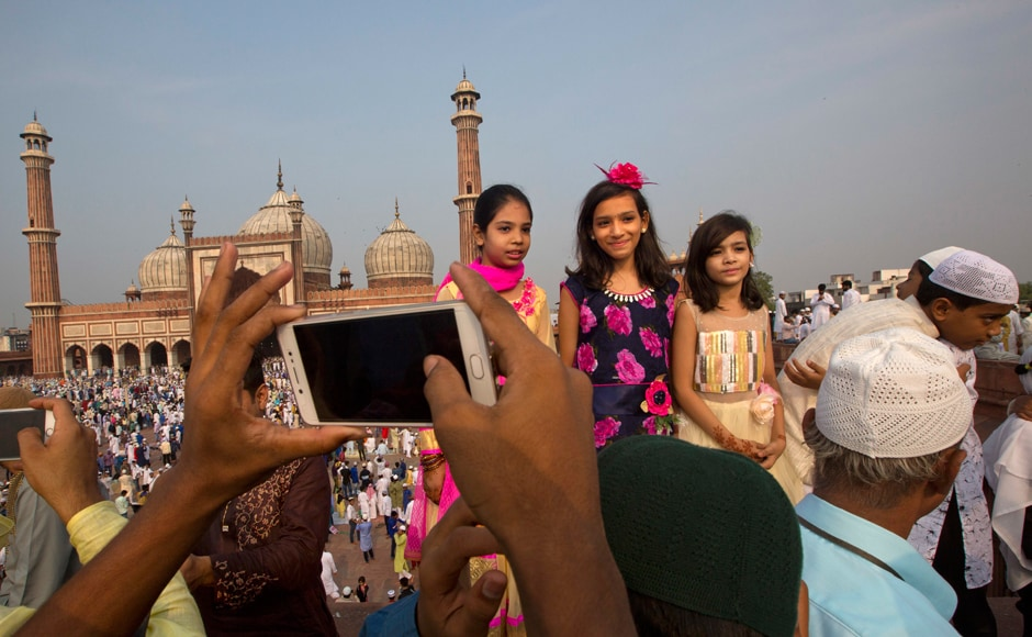 Muslims in Saudi Arabia, UAE and some other parts of the world celebrated Eid on Sunday. The timing of Eid can vary in different countries depending on the sighting of the new moon, which marks the start of the month in Islam's lunar calendar. Children show off their festive clothes outside the Jama Masjid in New Delhi. AP