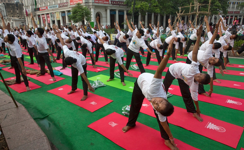 From the United Nations to the Great Wall of China, from Machu Pichu to Milan, yoga fever gripped the world. AP