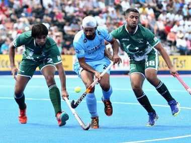 Talwinder Singh of India tangles with Muhammad Aleem Bilal and Muhammad Yaqoob of Pakistan during their match. Getty