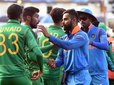India and Pakistan players greet each other after India's win the group stage. AFP