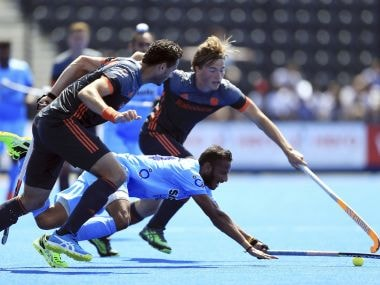 India's SV Sunil in action against the Netherlands during World Hockey League Semi-Finals. AP