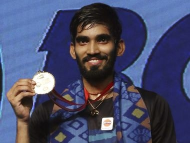 Srikanth Kidambi shows his medal during the victory ceremony after defeating Kazumasa Sakai. AP
