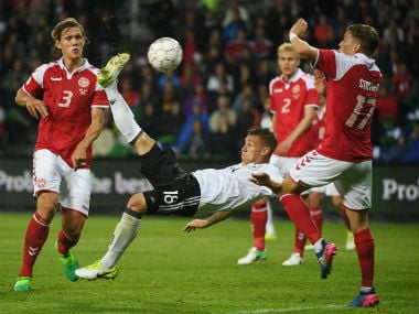 Bayern Munich's Joshua Kimmich scored an incredible bicycle kick to earn Germany a 1-1 draw against Denmark. Twitter: @UEFAEuro
