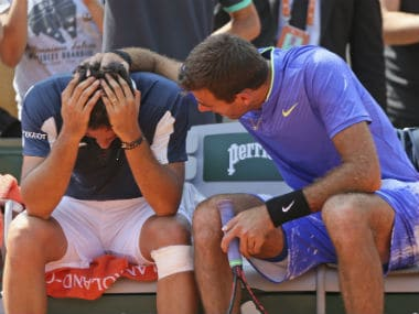 Juan Martin del Potro consoles Nicolas Almagro after the latter's injury-forced withdrawal. AP