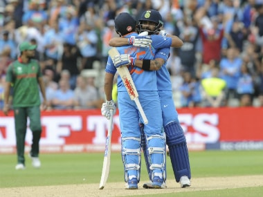 Virat Kohli, and Rohit Sharma celebrate after India's victory in the semifinal match against Bangladesh at Edgbaston. AP