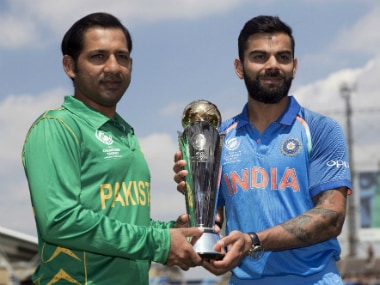 India's captain Virat Kohli, right, and Pakistan's captain Sarfraz Ahmed pose for a picture with the trophy at the Oval. AP