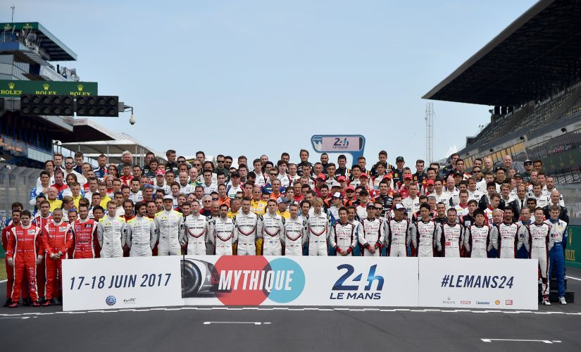 Drivers pose for picture on the race track before a free practice session for the Le Mans 24 hours endurance race. AFP