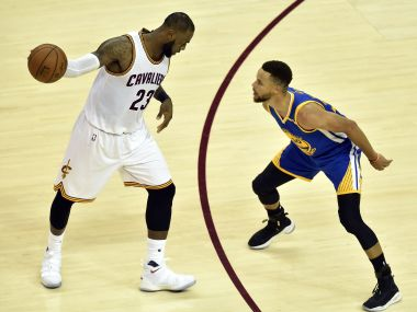 LeBron James handles the ball against Stephen Curry in Game 3 of the NBA Finals. Reuters