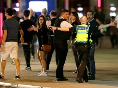 Police personnel cordoning the area after London Bridge attack. AP