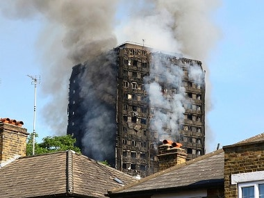 Smoke billows from from a high-rise apartment building on fire in London, Wednesday, June 14, 2017. A massive fire raced through the 27-story high-rise apartment building in west London early Wednesday, sending at least 30 people to hospitals, emergency officials said. AP
