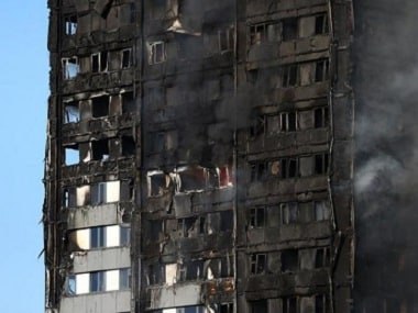 The burnt facade of a tower block is seen as firefighters tackle a serious fire at Latimer Road in West London, Britain June 14, 2017. REUTERS/Neil Hall