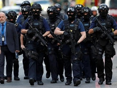 Armed police officers outside Borough Market after an attack left six people dead in London. Reuters