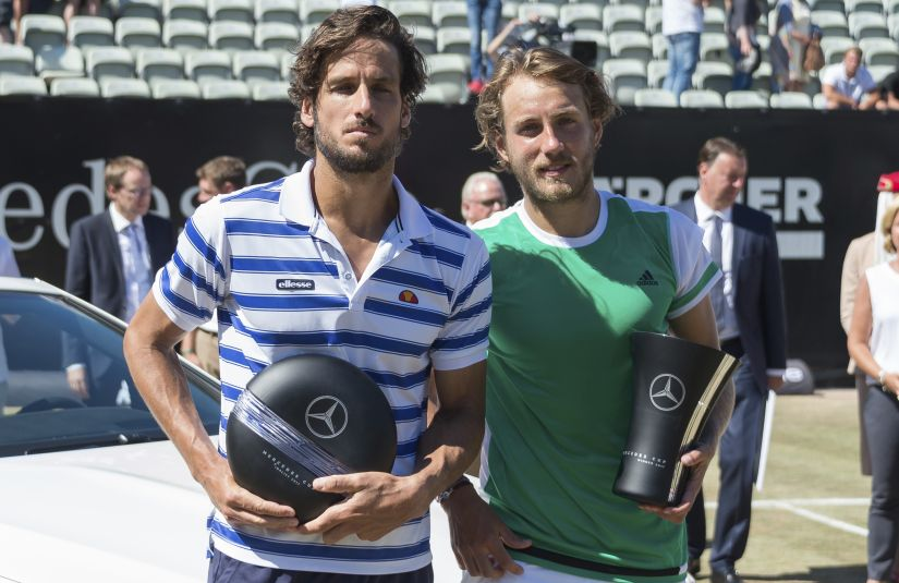 Winner Lucas Pouille, right, and Feliciano Lopez, left, pose during the trophy ceremony after the final match at Stuttgart Open. AP