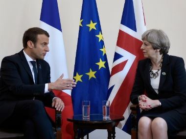 Britain's Prime Minister Theresa May and French President Emmanuel Macron talk during a bilateral meeting at the G7 Summit in Italy in May. Reuters