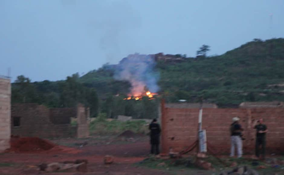 Smoke can be seen emanating from afire near the swimming pool area of the Campement Kangaba resort in Bamako, Mali. AP