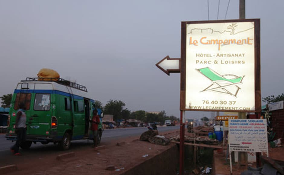 A sign board on the road shows Campement Kangaba resort. AP