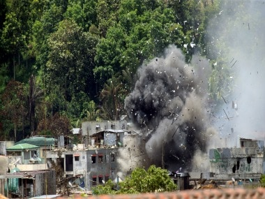 Debris and smoke seen after an Bronco aircraft released a bomb during an airstrike parts of Marawi City, Philippines June 20, 2017. Reuters