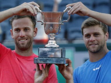 Ryan Harrison of the U.S. and Michael Venus of New Zealand, left, hold the trophy after winning the men's doubles final