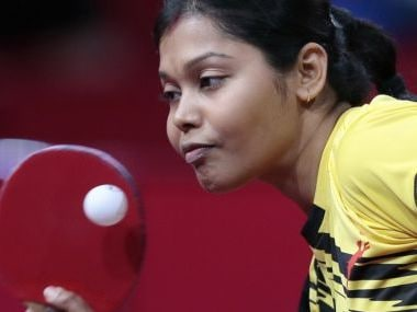 India's Mouma Das serves a ball to Hong-Kong Lee Ho Ching during the first round of the Women's Singles competition at the World Table Tennis Championships, on May 15, 2013, in Paris. AFP PHOTO / JACQUES DEMARTHON / AFP PHOTO / JACQUES DEMARTHON