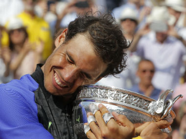 Rafael Nadal holds the cup after defeating Stan Wawrinka in the final at Roland Garros. AP