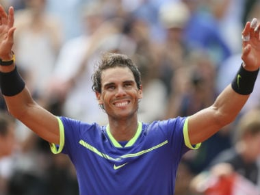 Rafael Nadal celebrates winning his tenth French Open title against Switzerland's Stan Wawrinka. AP