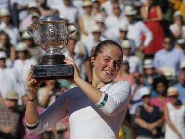 Jelena Ostapenko holds the French Open cup after defeating Simona Halep in the final at Roland Garros. AP