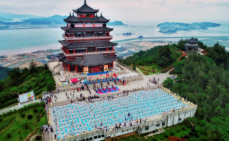 Yoga enthusiasts participate in an event to celebrate the 3rd International Day of Yoga in Wenzhou, China on Sunday. Image courtesy: PTI Photo