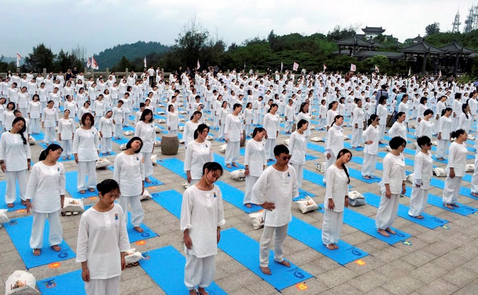 Yoga enthusiasts participate in an event to celebrate 3rd International Day of Yoga in Wenzhou, China on Sunday. Image courtesy: PTI