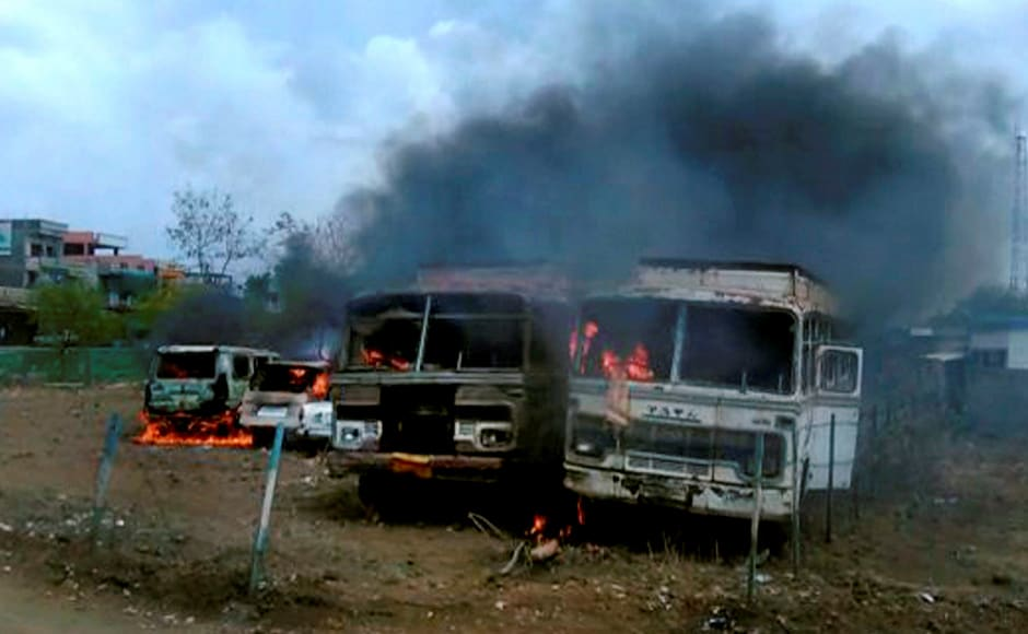 Chartered buses after being torched by agitating farmers at the Bhopal-Indore highway in Dewas district. PTI