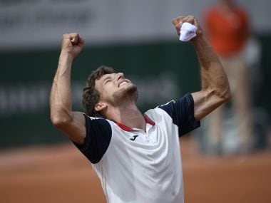 Pablo Carreno Busta celebrates after winning against Milos Raonic at the French Open. AFP