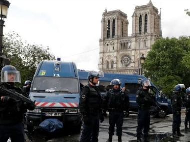 French police stand at the scene of a shooting incident near the Notre Dame Cathedral in Paris. Reuters