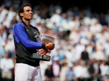 An emotional Rafael Nadal holds the La Coupe des Mousquetaires after beating Stan Wawrinka. Reuters