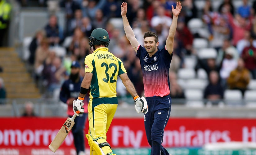 England's Mark Wood celebrates the wicket of Australia's Glenn Maxwell. Reuters