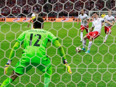 Poland's Robert Lewandowski scores their third goal from the penalty spot to complete his hat-trick. Reuters