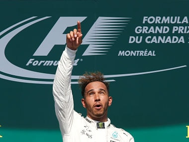 Formula One - F1 - Canadian Grand Prix - Montreal, Quebec, Canada - 11/06/2017 - Mercedes' Lewis Hamilton celebrates after winning the race on the podium. REUTERS/Chris Wattie TPX IMAGES OF THE DAY - RTS16N80