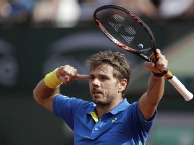 Stan Wawrinka celebrates after beating Gael Monfils at the French Open on Monday. AP Photo
