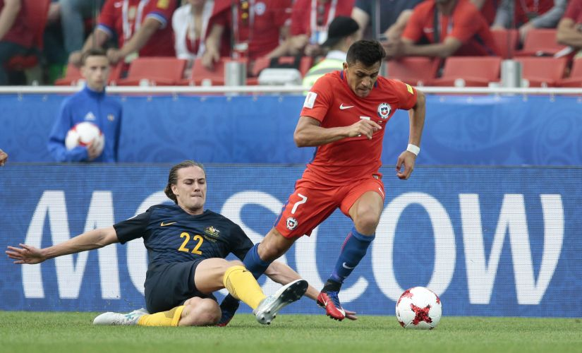 Chile's Alexis Sanchez, right, escapes Australia's Jackson Irvine during the Confederations Cup, Group B soccer match between Chile and Australia, at the Spartak Stadium in Moscow, Sunday, June 25, 2017. (AP Photo/Ivan Sekretarev)