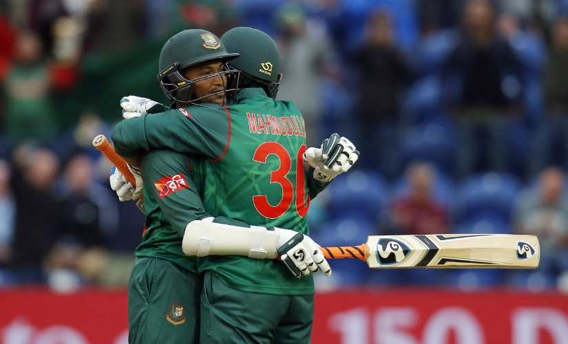 Bangladesh's Shakib Al Hasan celebrates scoring a century with teammate Mahmudullah at Cardiff. Reuters