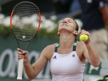 Simona Halep celebrates as she defeats Karolina Pliskova in their semi-final match. AP