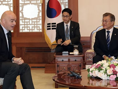South Korean President Moon Jae-in, right, talks with FIFA President Gianni Infantino during their meeting at the presidential Blue House in Seoul, South Korea, Monday, June 12, 2017. South Korea's new liberal president Moon has proposed on Monday that the rival Koreas and other Northeast Asian countries co-host the 2030 World Cup. (Bae Jae-man/Yonhap via AP)