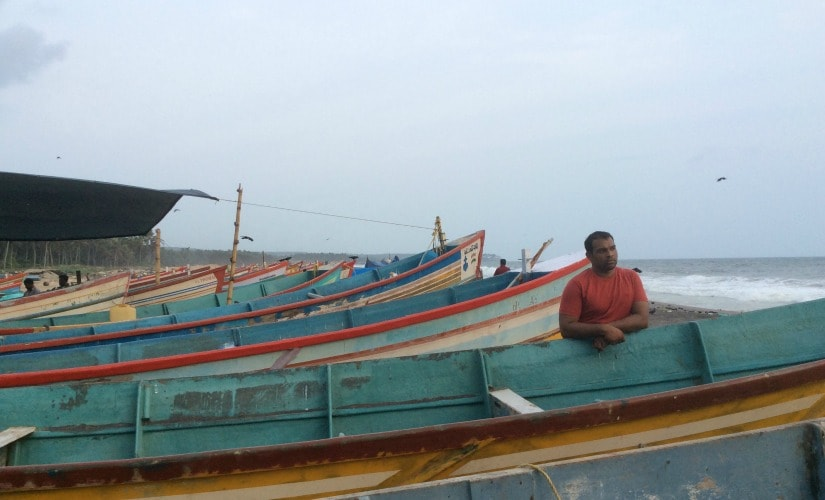 Suresh Robert standing near his boat. Firstpost/Rejimon K