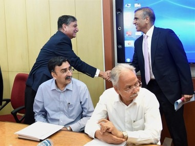 New Delhi: Sunil Bharti Mittal, founder and Chairman, Bharti Enterprises greets Ishaat Hussain of Tata Sons during a meeting with Telecom Minister Manoj Sinha at Sanchar Bhavan in New Delhi on Thursday to discuss financial difficulties being faced by the telecom sector. PTI
