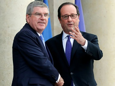 File image of International Olympic Committee (IOC) President Thomas Bach with former French President Francois Hollande. Reuters