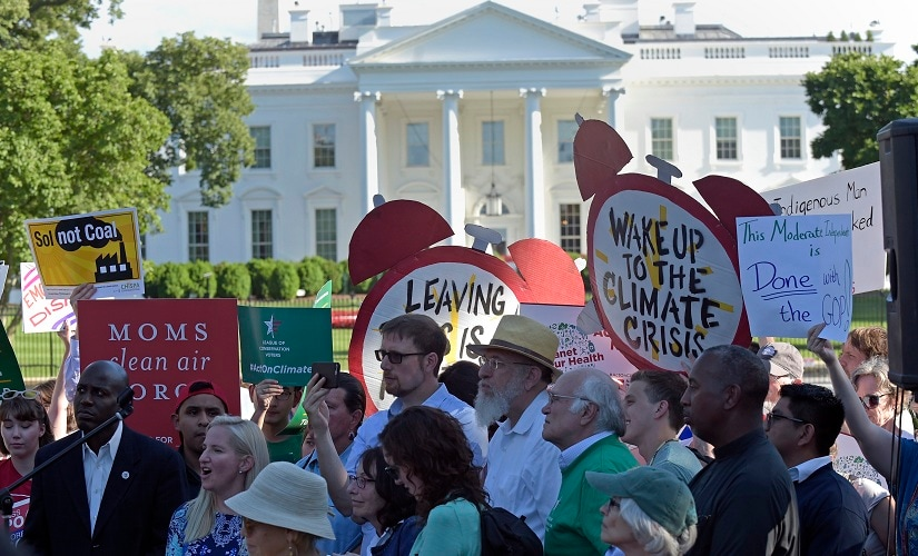 Protesters gather outside the White House to protest President Donald Trump's decision to withdraw the Unites States from the Paris climate change accord. AP