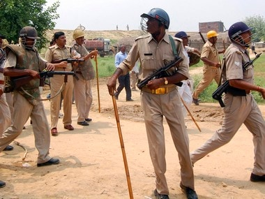 Police try to disperse protesting farmers during the protests in Madhya Pradesh. Reuters