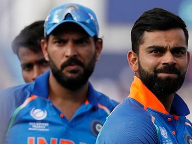 India's captain Virat Kohli looks on as Pakistan celebrate a 180-run win over their arch-rivals. AP