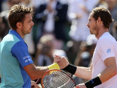 Switzerland's Stan Wawrinka, left, shakes hands with Britain's Andy Murray after their semifinal match of the French Open tennis tournament at the Roland Garros stadium, Friday, June 9, 2017 in Paris. Wawrinka won 6-7 (6), 6-3, 5-7, 7-6 (3), 6-1. (AP Photo/David Vincent)