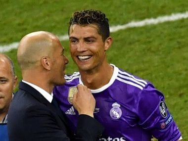 Real Madrid coach Zinedine Zidane (L) with Cristiano Ronaldo (R). AFP